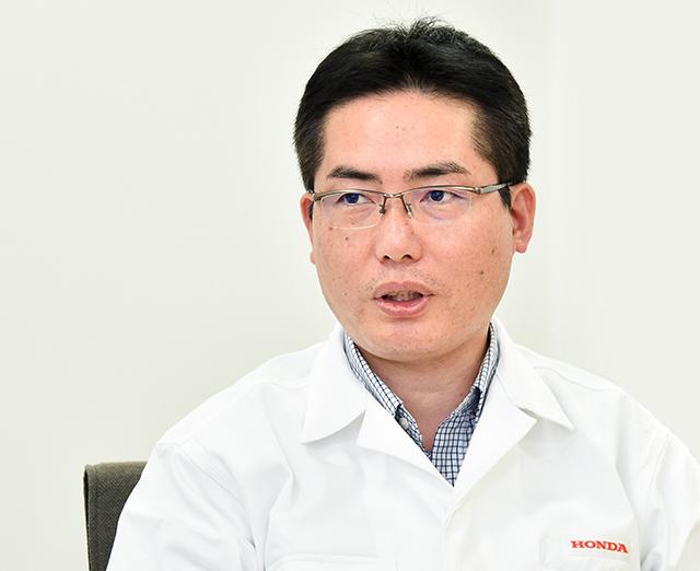 石﨑 哲男 氏